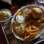 News-Herald Media reporter Mitch Skurzewski's meal included beer-battered fried fish, poor man's lobster (cod), French fries and homemade coleslaw, potato salad and a dinner roll at the Buck-A-Neer Supper Club in Rozelville, Friday, June 5, 2015.
