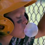 Jacob Byk/USA TODAY NETWORK - Wi An Edgar little league player blows a gum bubble in the dugout during the opening day of Small Town Baseball State Championships in Marshfield, June 24, 2016. An Edgar little league player blows a gum bubble in the dugout during the opening day of Small Town Baseball State Championships in Marshfield, June 24, 2016.