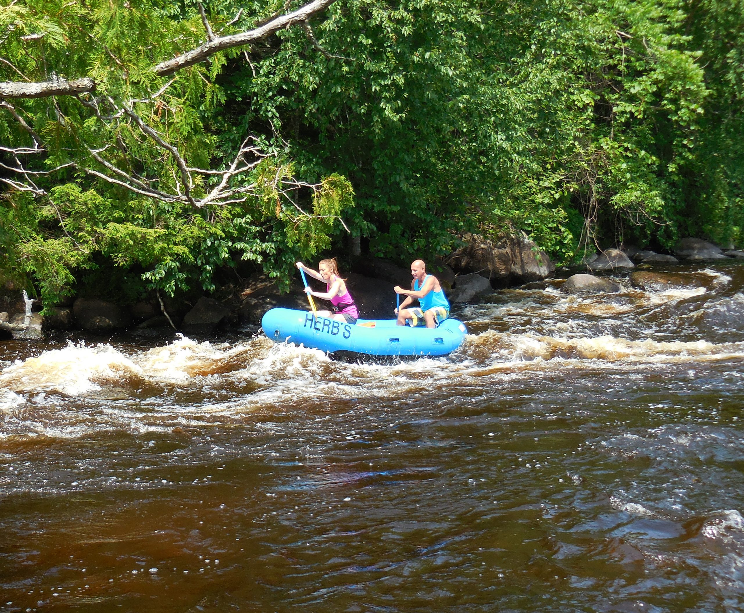 Rafting down the Wolf River at Gilmore's Mistake