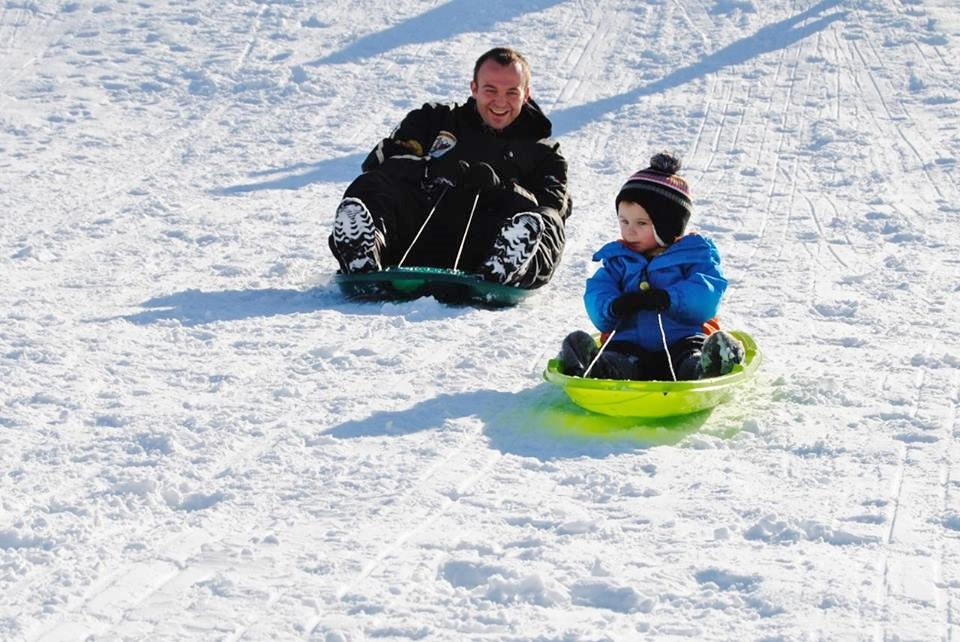 Father and son sledding in Wisconsin Rapids.